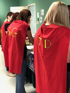 HR staff in super hero capes during an employee appreciation luncheon