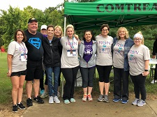 Staff and leadership pictures after a COMTREA 5K fundraiser.